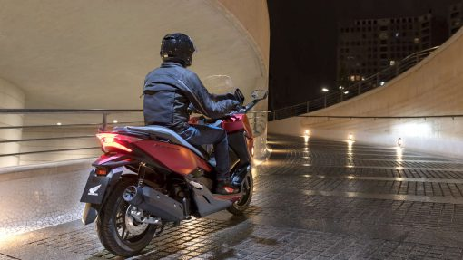 Honda Forza 125 scooter in night action