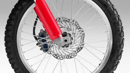 Honda CRF250L motorbike - Red colour, close view, wheel