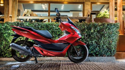 Honda PCX - Red colour, parked, CMG