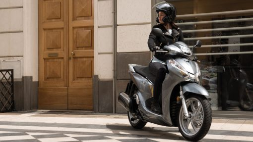 SH300 - female driver, Scooters LTD